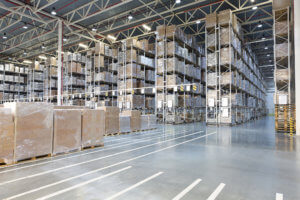 Huge distribution warehouse with boxes on high shelves